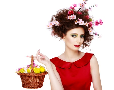 Easter Woman. Spring Girl with Fashion Hairstyle. Portrait of Beautiful Model with Colorful flowers