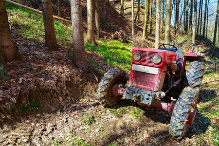 old tractor in forest at work