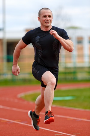 healthy man run on athletics race sport track and representing concept of sport and speed