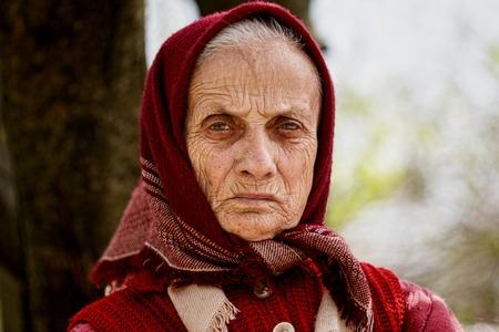kerchief: Old rural woman with kerchief outdoor