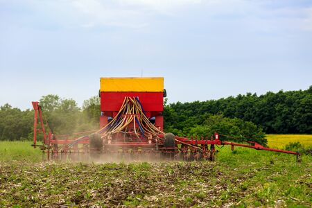 mechanization: agricultural work plowing land on a powerful tractor Stock Photo