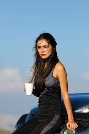 caucasian girl: A beautiful sporty caucasian girl drinking water after exercise