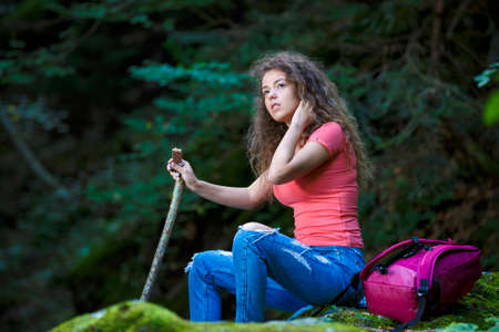 recreational climbing: Young European woman hiker by the river, outdoors activities