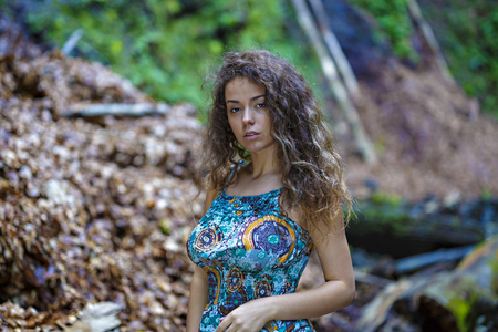 portrait of a beautiful woman with curly hair in nature Stock Photo