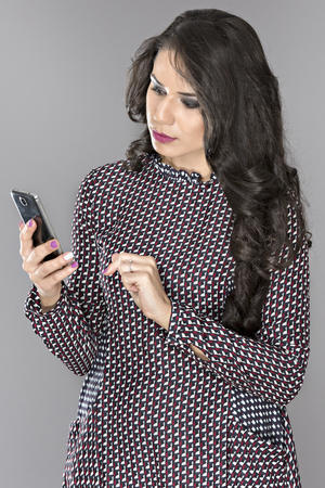 isolated on gray: beautiful business woman with a cell phone isolated gray background