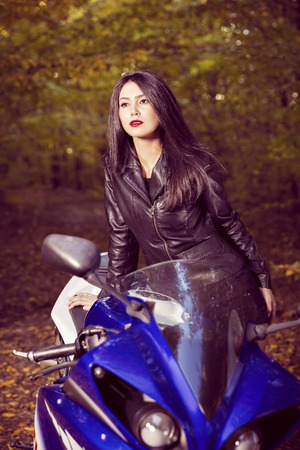 biker girl: Beautiful Biker girl on a motorcycle