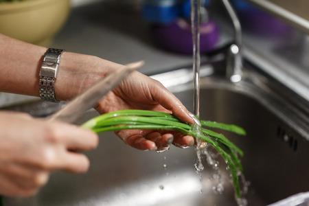 green onion: Women wash green onions