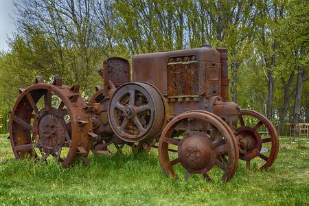 old metal tractor left on a farm Foto de archivo