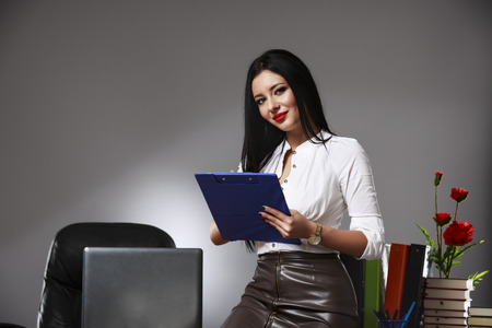 attractive  female: Portrait of a business woman in an office Stock Photo