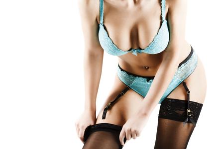 Woman putting on black stockings Stock Photo