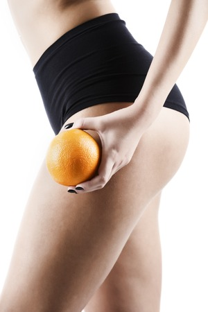 cellulite - orange skin effect in womens thighs, isolated on background Stock Photo
