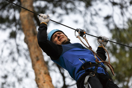 Man on a difficult course in an adventure park Stock Photo