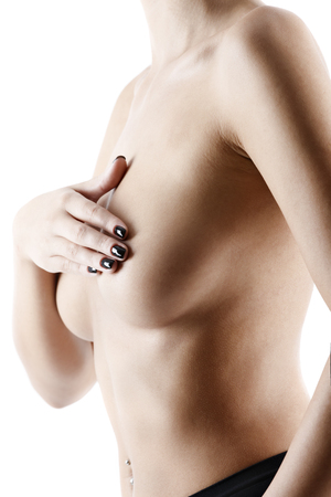 Beautiful slim woman covering her nude breast isolated on white background Stock Photo