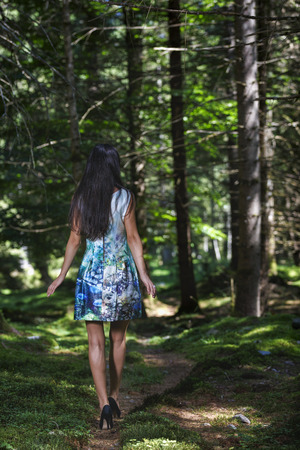 fashion brunette woman in woods Stock Photo