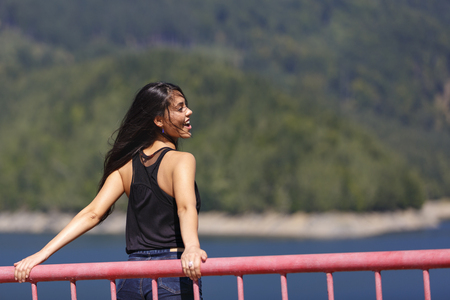 woman sits on the edge of a dam Stock Photo