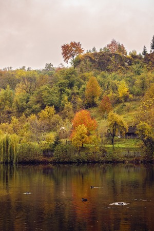landscape with reflections of autumn colors on a lake Stock Photo