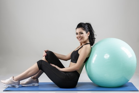 beautiful woman with a ball isolated on background 版權商用圖片