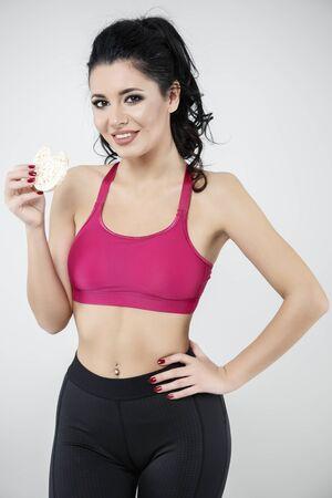 barra de cereal: diet sporty young woman eating cereal bar Foto de archivo