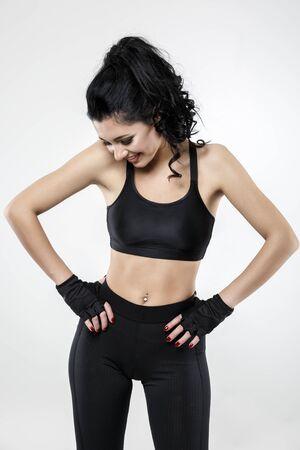 beautiful brunette woman doing various exercise fitness Standard-Bild
