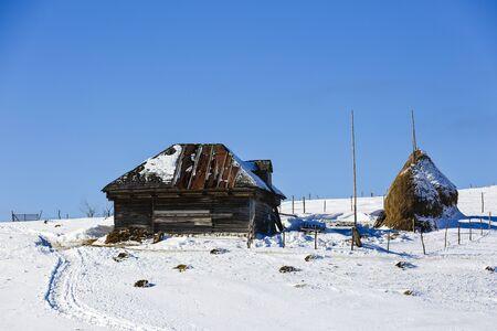 haystacks in winter mountain somewhere in Romania