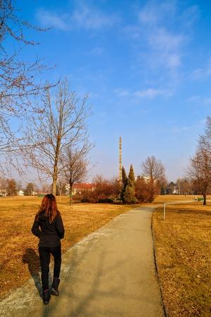 constantin: woman tourist traveling through Romania. Targu Jiu, endless column