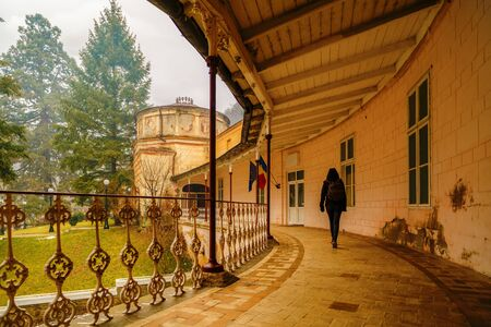 baile: woman tourist traveling through Romania. old Roman empire, resort Baile Herculane Editorial
