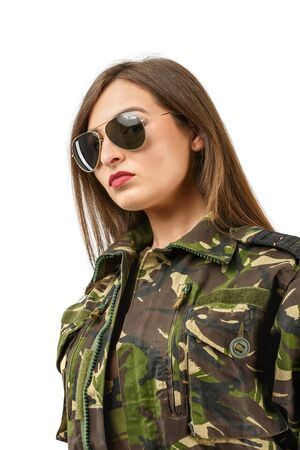 khaki: portrait of a beautiful woman soldier with camouflage uniform and sunglasses