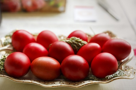Bowl with red eggs on a table Stock Photo