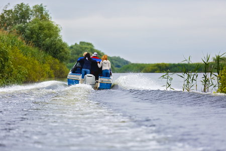 danubian: Boat with tourists in the Danube Delta