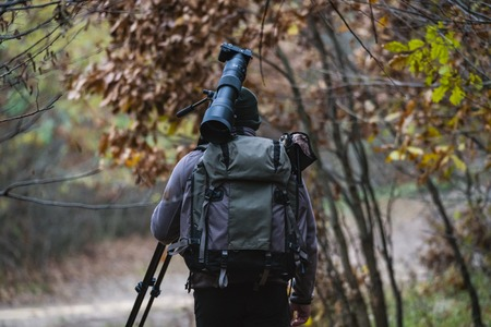 professional photographer with camouflage outfit in nature Stock Photo