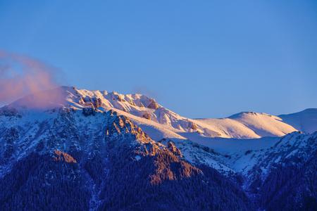beautiful winter landscape with the Bucegi Mountains in Romania Stock Photo