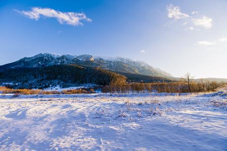 Beautiful winter landscape with Carpati Piatra Craiului mountains in Romania