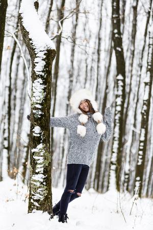 beautiful young woman enjoying winter in the woods Фото со стока