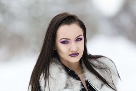 winter portrait with a woman with colored eyes