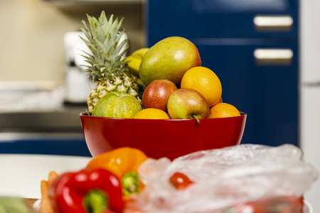 Many exotic fruits in a bowl in the kitchen