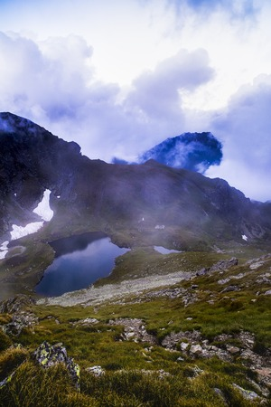 Landscape with glacial lake Capra in Fagaras mountains, Romania