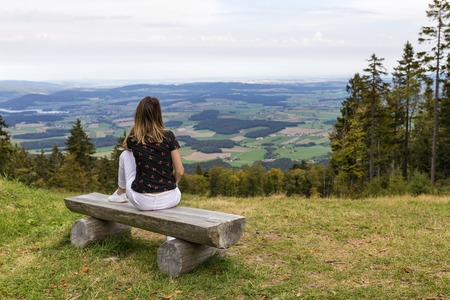 woman  looking at amazing woods and mountains in summer, travel concept, space for text Banco de Imagens