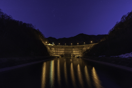 Dam lake under starry night sky