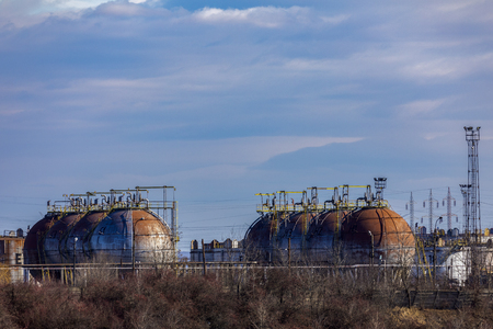 Oil refinery with facilities, tanks and trains
