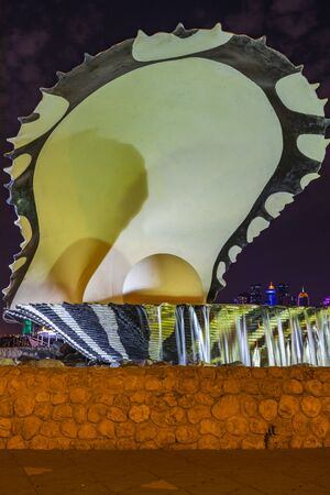 Doha, Qatar - 18-01-2020: Famous monument Shell with Perl is landmark of Doha, Qatar. Monument of Shell at night.