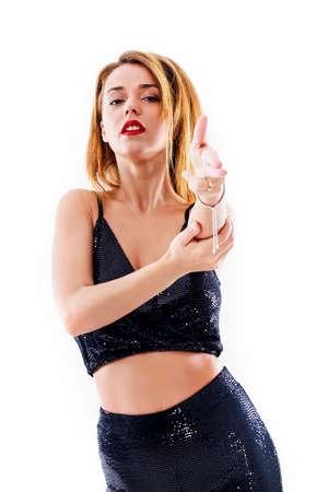 Beautiful woman in black bell bottom pants, on white 免版税图像