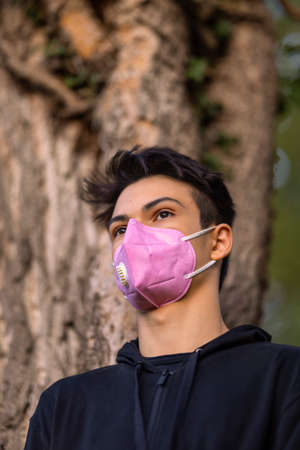 Young Man in the Flu Mask in the Autumn Park Stock fotó