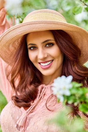 Beautiful natural woman in the garden of apple Stock fotó