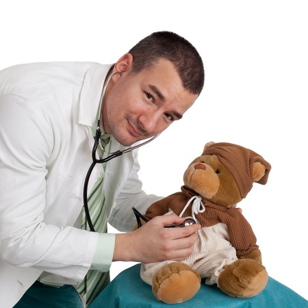 paediatrician: Male pediatrician and teddy bear. Isolated on white background.