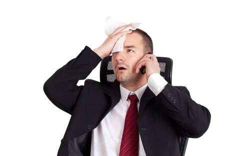 wiping: Bad news. Businessman holding forehead. Isolated on white background