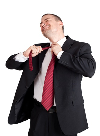 strangling: Business man strangling himself with tie. Isolated on white background Stock Photo