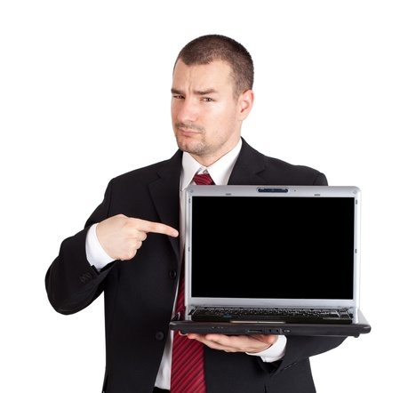Young businessman pointing on laptop with blank screen  Isolated on white background