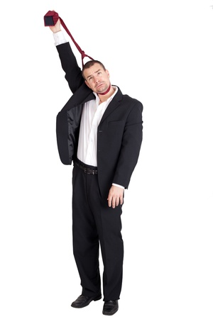 strangling: Business man strangling himself with tie  Isolated on white background