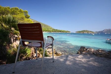 chair, beach and sea - Formentor, Mallorca photo