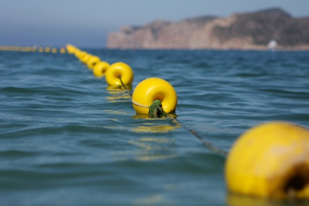 yellow buoy in the sea photo